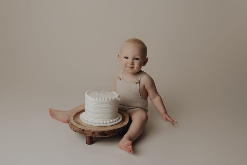 one year old getting cake for his cake smash photo session