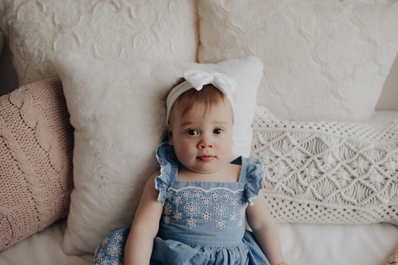 baby girl on a lifestyle setup getting her one year photos taken