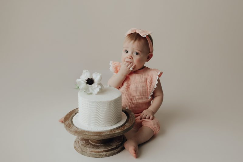 one year old eating cake