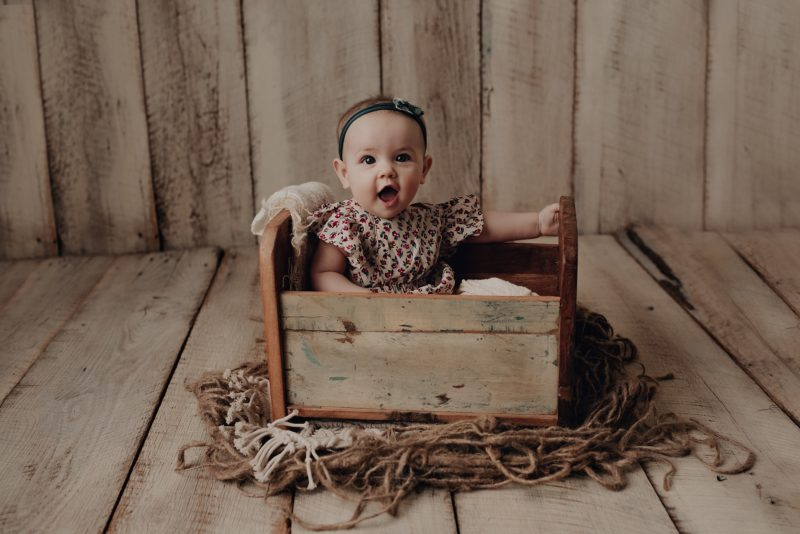 6 month old  on barnwoodi in a baby cradle