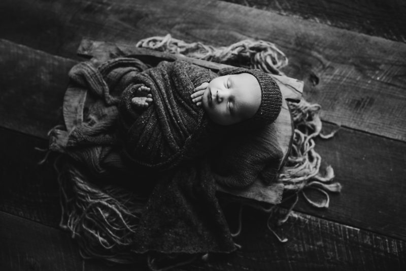black and white of newborn baby