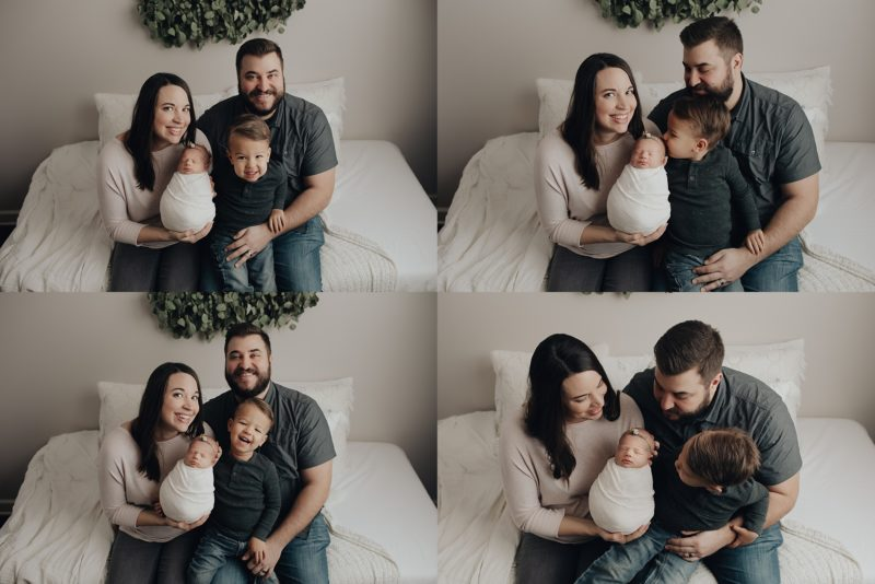 Family getting photos with newborn baby girl