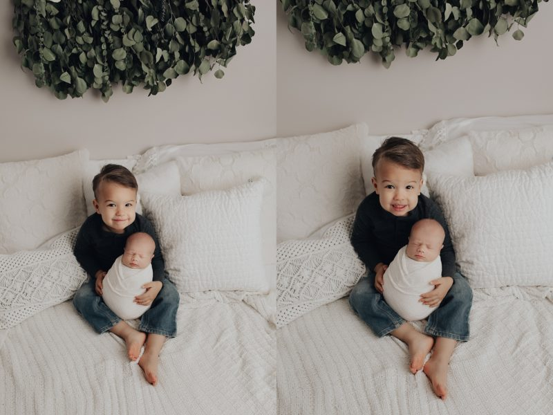 Big brother holding his sister