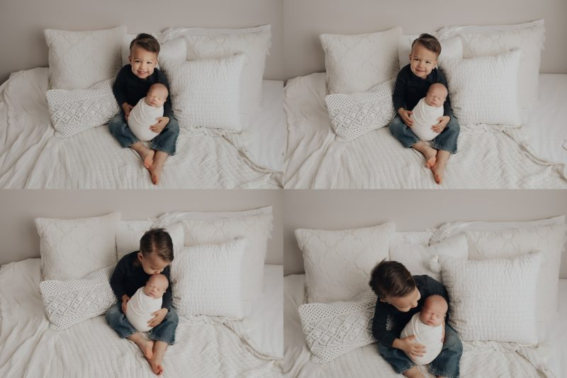 big brother holding and kissing on his brother