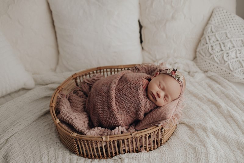 baby girl in a prop for newborn pics