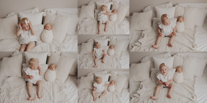 Big sister getting photos taken with her newborn baby sister.