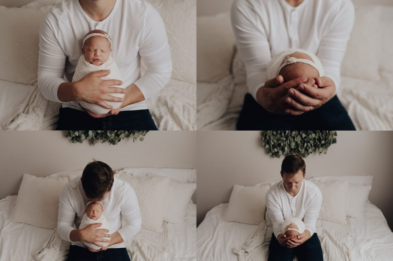 dad holding his sweet baby girl for newborn photos
